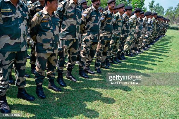 Indian Border Security Force soldiers pay homage to slain soldiers who lost their lives in Kargil War at a war memorial inside a Border Security...