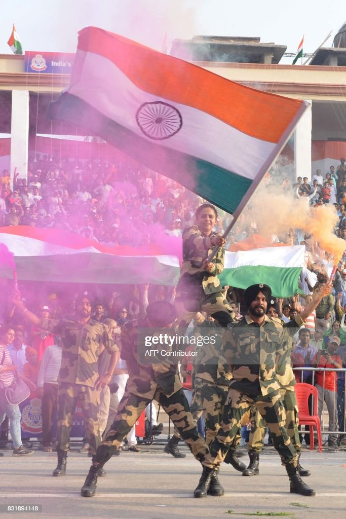Indian Border Security Force soldiers perform during a ceremony to mark India`s 70th Independence Day celebrations at the IndiaPakistan Wagah border..