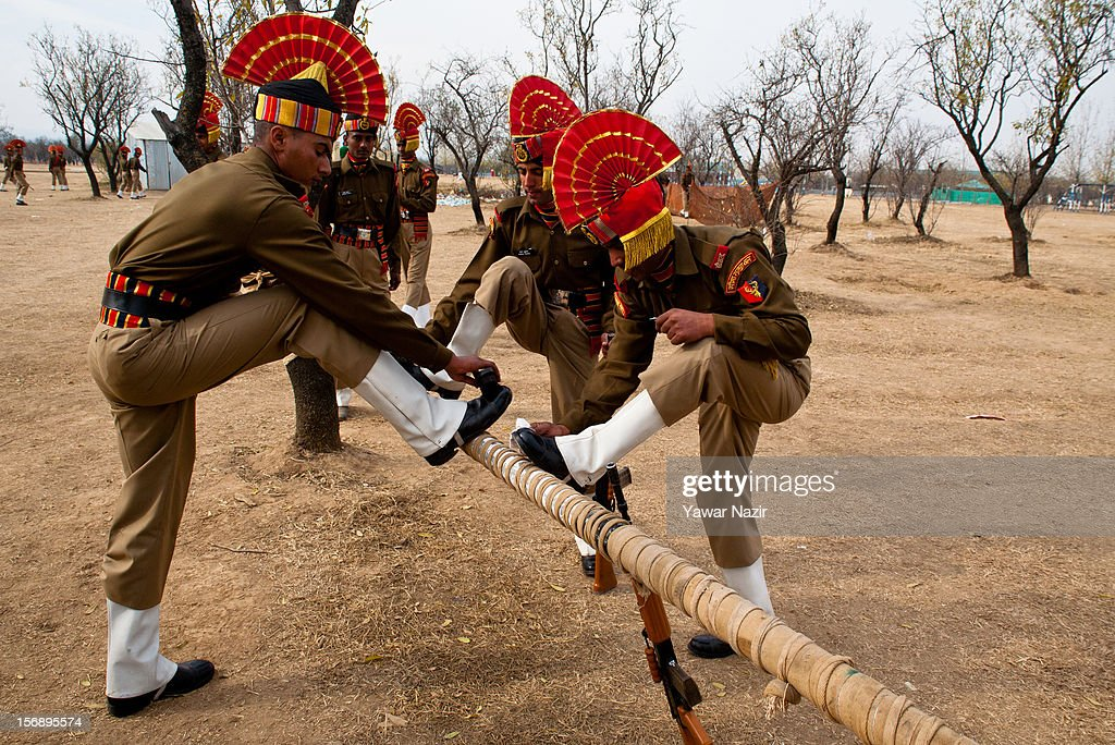Indian Border Security Force (BSF) soldiers polish their shoes before their passing out parade on November 24, 2012 in Humhama, on the outskirts of Srinagar, the summer capital of Indian administered Kashmir, India. 545 new trained recruits of the Indian paramilitary Border Security Force constables took oaths during their passing out parade after successfully completing 36 weeks of basic training which involved physical fitness, weapons handling, map reading, counter-insurgency operations and human rights. The recruits will join Indian soldiers to fight militants in Kashmir, a spokesman of the paramilitary BSF said. India has already close to a million soldiers posted in Jammu and Kashmir, making the disputed Himalayan region one of the most militarized zone in the world