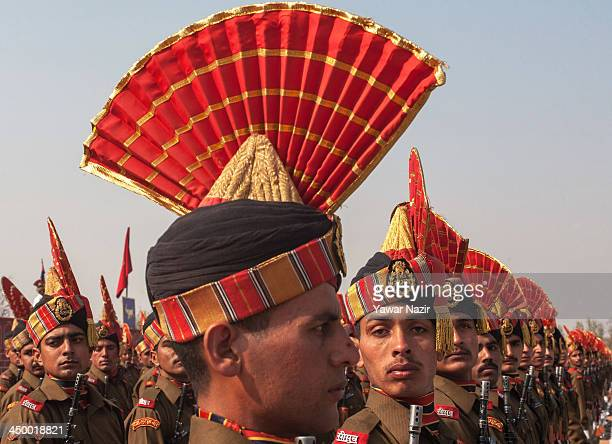 Indian Border Security Force soldiers stand in formation during their passing out parade on November 16 2013 in Humhama on the outskirts of Srinagar...