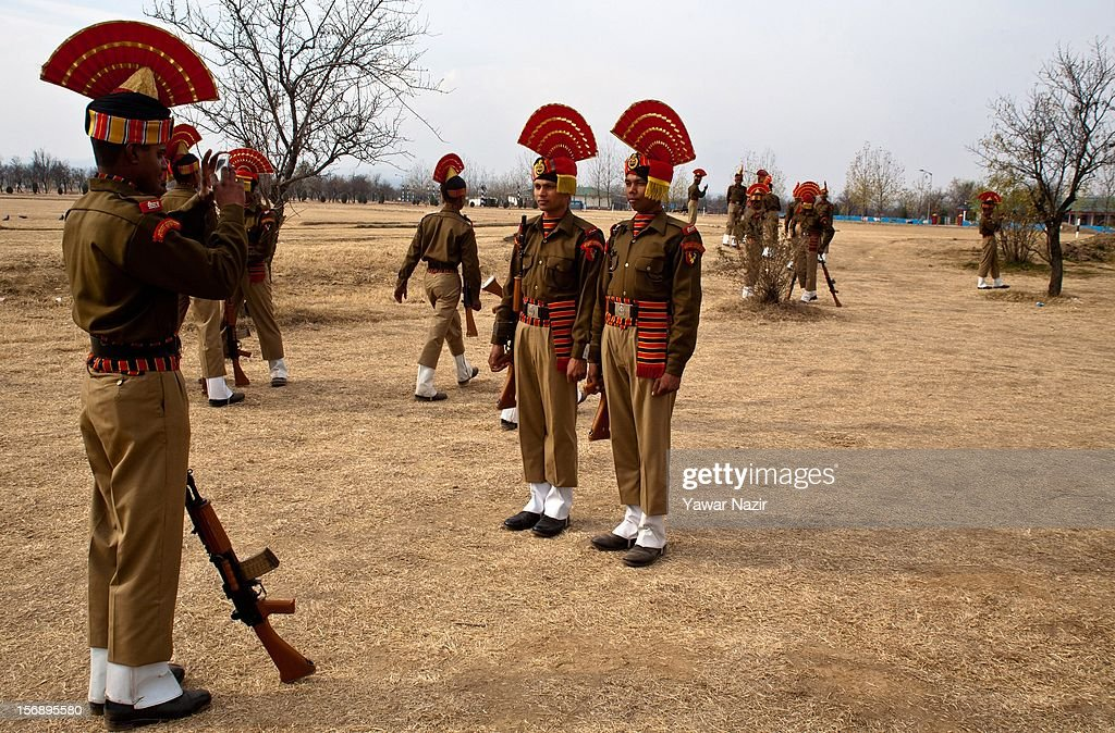 Indian Border Security Force (BSF) soldiers take photographs before their passing out parade on November 24, 2012 in Humhama, on the outskirts of Srinagar, the summer capital of Indian administered Kashmir, India. 545 new trained recruits of the Indian paramilitary Border Security Force constables took oaths during their passing out parade after successfully completing 36 weeks of basic training which involved physical fitness, weapons handling, map reading, counter-insurgency operations and human rights. The recruits will join Indian soldiers to fight militants in Kashmir, a spokesman of the paramilitary BSF said. India has already close to a million soldiers posted in Jammu and Kashmir, making the disputed Himalayan region one of the most militarized zone in the world
