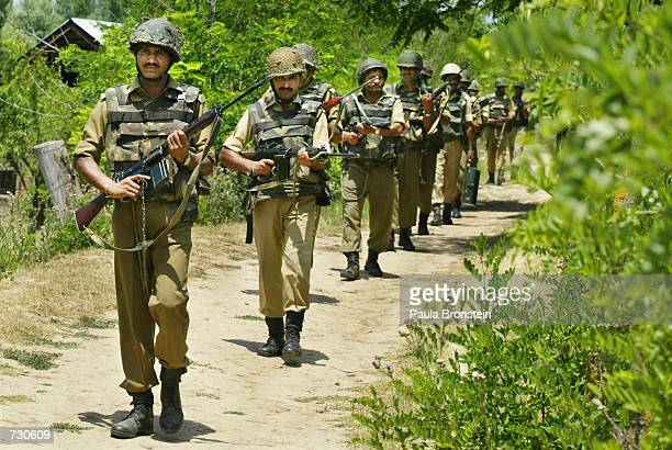 Indian Border Security Force soliders march during a mock training exercise in counterinsurgency June 14 2002 near Srinagar Kashmir Tensions have...