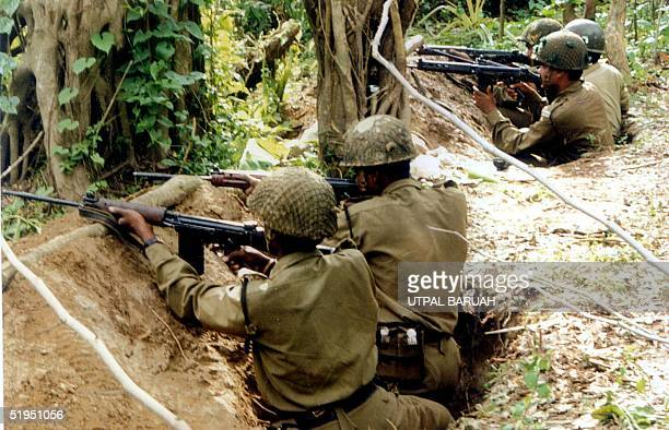 Indian Border Security Force troops guard the IndoBangladesh border near Dawki in the northeastern state of Meghalaya 19 April 2001 Fresh fighting...