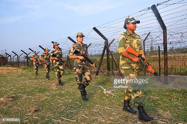 Indian Border Security Force women soldiers patrolling at the near Petrapole Border outpost at the IndiaBangladesh Border on the outskirts of...