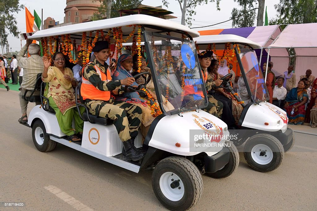 Indian Border Security Forcepersonnel drive golf carts with elderly passengers at The Wagah Border Post on April 2 2016 The BSF Wives Welfare...