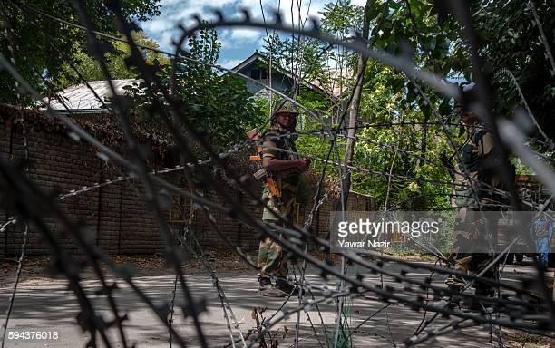 Indian border security forces stand guard in the city center during a curfew following weeks of violence that has left over 69 people dead and...