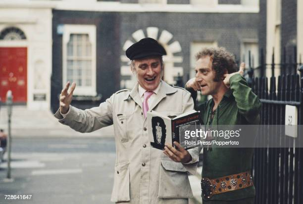 Indian born British comedian Spike Milligan on left reads from his recently published autobiographical book 'Adolf Hitler My Part in His Downfall' as...