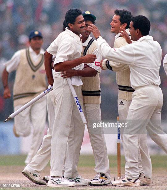 Indian bowler Anil Kumble is congratulated by his teammates after dissmissing Pakistan's Wasim Akram to win the second test 07 February 1999. Kumble...