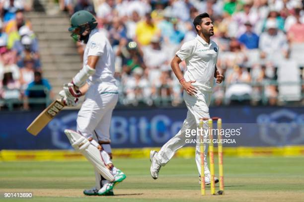 Indian bowler Bhuvneshwar Kumar celebrates the dismissal of South African batsman Hashim Amla during Day One of the First Test cricket match between...