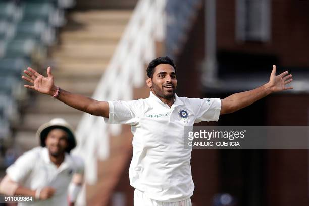 Indian bowler Bhuvneshwar Kumar celebrates the dismissal of South African batsman Kagiso Rabada during the fourth day of the third Test match between...