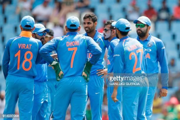 Indian bowler Bhuvneshwar Kumar celebrates the dismissal South African batsman Hashim Amla during the second One Day International cricket match...