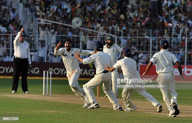 Indian bowler Harbhajan Singh celebrates with teammates as India beat South Africa and level the series during the final day of the second Test match...