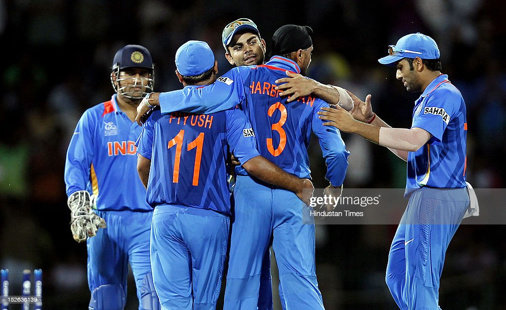 Indian bowler Harbhajan Singh is congratulated by team players after dismissal of England batsman Jos Buttler during the ICC T20 World Cup cricket match between India and England at R. Premadasa Stadium on September 23, 2012 in Colombo, Sri Lanka.