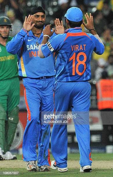 Indian bowler Harbhajan Singh is congratulated by teamates for getting out South African Colin Ingram during the 2nd One Day International between...