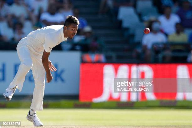 Indian bowler Hardik Pandya bowls on Aiden Markram during the second day of the first Test cricket match between South Africa and India at Newlands...