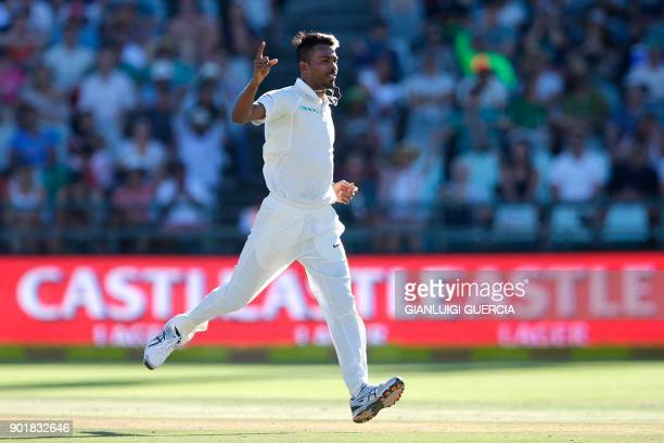 Indian bowler Hardik Pandya celebrates the dismissal of South African batsman Aiden Markram during the second day of the first Test cricket match...