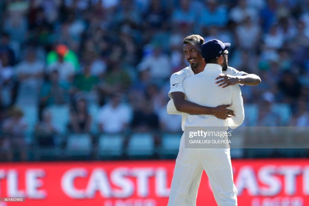 Indian bowler Hardik Pandya (L) celebrates the dismissal of South African batsman Aiden Markram (not in picture) during the second day of the first Test cricket match between South Africa and India at Newlands cricket ground on January 6, 2018 in Cape Town. /