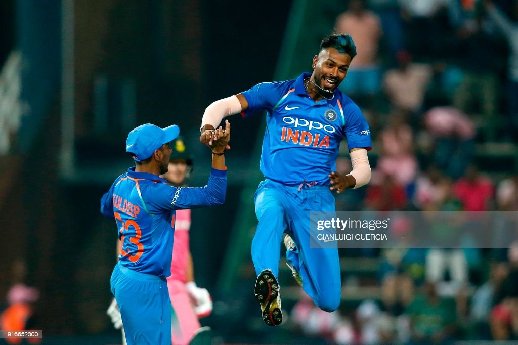 Indian bowler Hardik Pandya (R) celebrates the dismissal of South African batsman AB de Villiers (not pictured) during the fourth One Day International cricket match between South Africa and India at Wanderers cricket ground on February 10, 2018 in Johannesburg, South Africa. /
