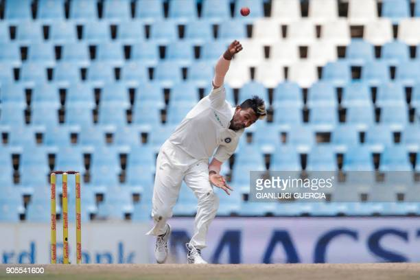 Indian bowler Hardik Pandya delivers on South African batsman Faf du Plessis during the fourth day of the second Test cricket match between South...