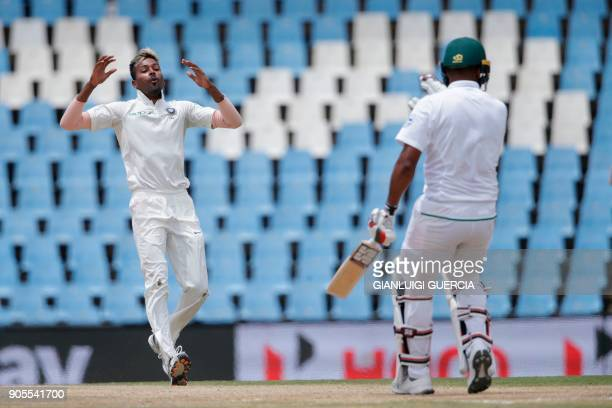 Indian bowler Hardik Pandya reacts after bowling on South African batsman Vernon Philander during the fourth day of the second Test cricket match...