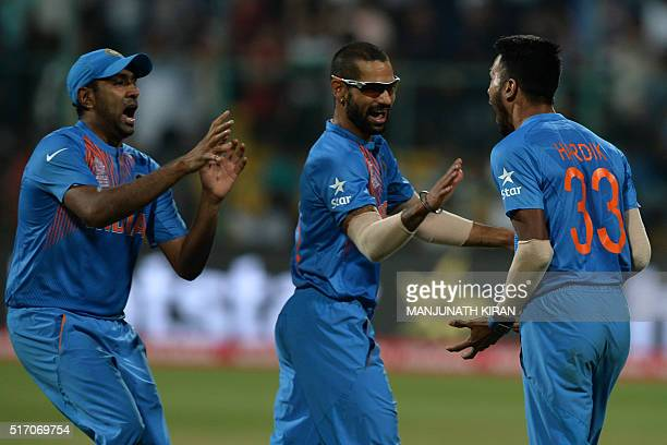 Indian bowler Hardik Pandyacelebrates with teammates Shikhar Dhawanand Ravichandran Ashwin the wicket that led to the victory of India in the last...
