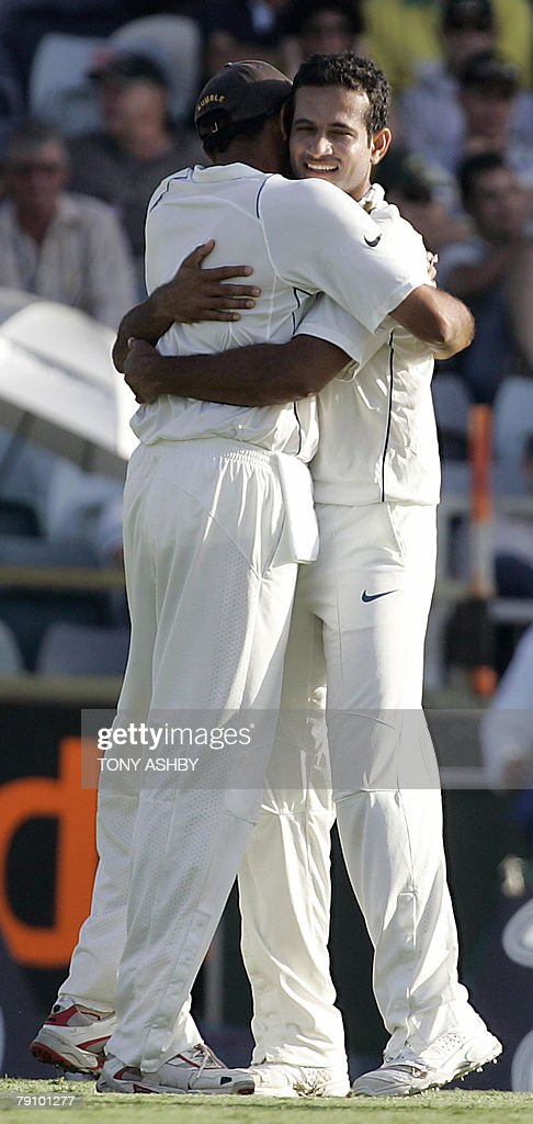 Indian bowler Irfan Pathan (R) celebrates with a teammate after taking the wicket of Australian opening batsman Chris Rogers (not in photo) during the third day of the third Test against Australia at the WACA ground in Perth, 18 January 2008. India finished their second innings with 294 runs. RESTRICTED TO EDITORIAL USE PUSH TO MOBILE SERVICES OUT. AFP PHOTO/Tony ASHBY