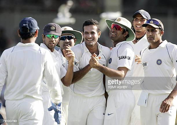 Indian bowler Irfan Pathan celebrates with teammates after taking the wicket of Australian opening batsman Chris Rogers during the third day of the...