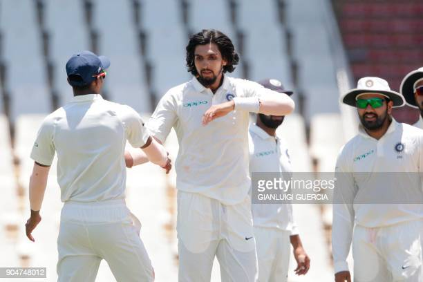 Indian bowler Ishant Sharma celebrates the dismissal of South African batsman and Captain Faf du Plessis during the second day of the second Test...