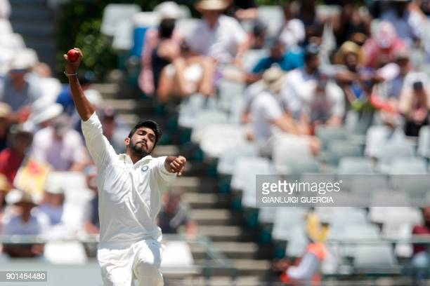 Indian bowler Jasprit Bumrah bowls on South African batsman AB de Villiers during Day One of the cricket First Test match between South Africa and...