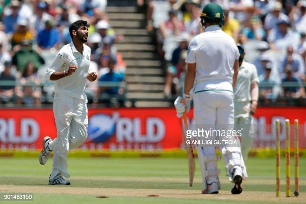 Indian bowler Jasprit Bumrah celebrates the dismissal of South African batsman AB de Villiers during Day One of the cricket First Test match between...