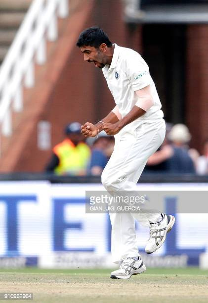 Indian bowler Jasprit Bumrah celebrates the dismissal of South African batsman Quinton de Kock during the fourth day of the third test match between...