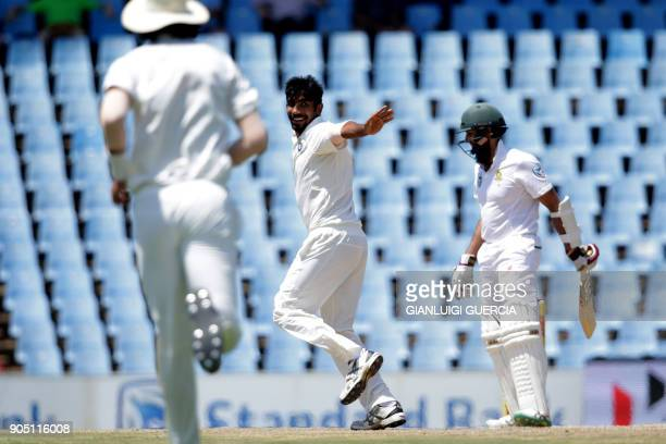 Indian bowler jasprit Bumrah celebrates the dismissal of South African batsman Hashim Amla during the third day of the second Test cricket match...