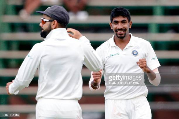 Indian bowler Jasprit Bumrah celebrates the dismissal of South African batsman Hashim Amla during the second day of the third test match between...