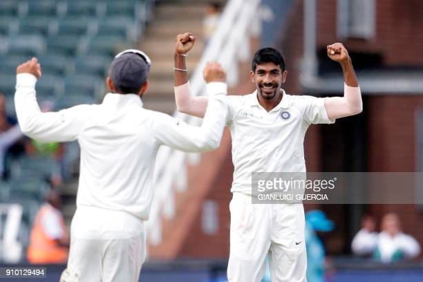 Indian bowler Jasprit Bumrah celebrates the dismissal of South African batsman Lungi Ngidi during the second day of the third test match between...