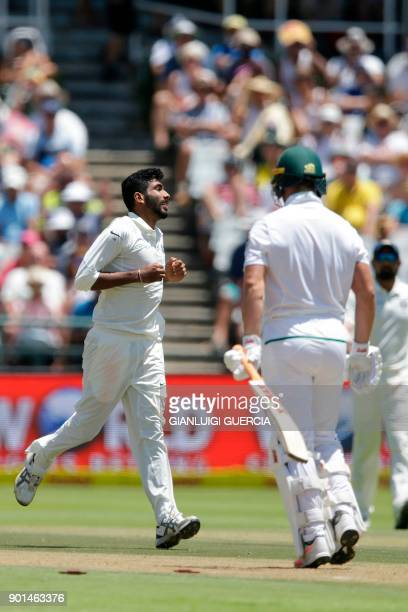 Indian bowler Jasprit Bumrah celebrates the dismissal South African batsman AB de Villiers during Day One of the cricket First Test match between...