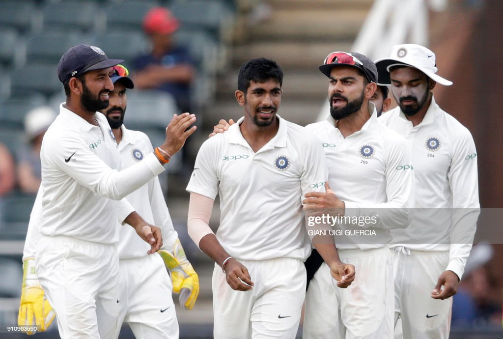 Indian bowler Jasprit Bumrah (C), Indian Captain Virat Kohli (2R) and teammates celebrate the dismissal of South African batsman Quinton de Kock during the fourth day of the third test match between South Africa and India at Wanderers cricket ground in Johannesburg on January 27, 2018. /