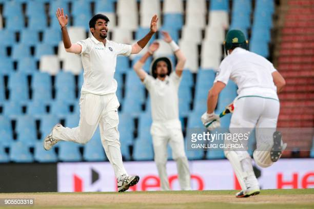 Indian bowler Jasprit Bumrah reacts after bowling on South African bowler AB de Villiers during the third day of the second Test cricket match...