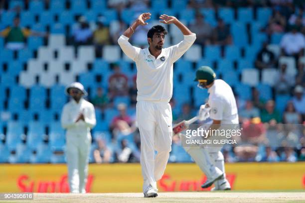 Indian bowler Jasprit Bumrah reacts as South African batsmen take runs during the first day of the second Test cricket match between South Africa and...