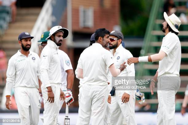 Indian bowler Jasprit Bumrah with teammates celebrates the dismissal of South African batsman Hashim Amla during the second day of the third test...