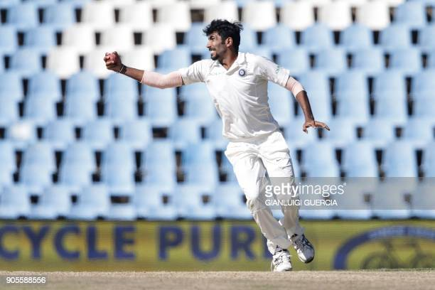 Indian bowler Jasprit Burmah catches on his own bowling as he dismissing South African batsman and Captain Faf du Plessis during the fourth day of...