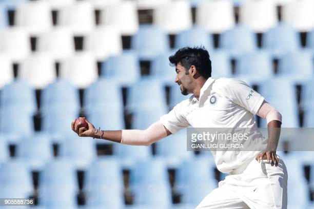 Indian bowler Jasprit Burmah catches on his own bowling to dismiss South African batsman and Captain Faf du Plessis during the fourth day of the...