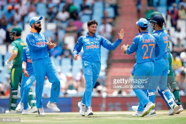 Indian bowler Kuldeep Yadav celebrates the dismissal of South African batsman Kagiso Rabad during the second One Day International cricket match...