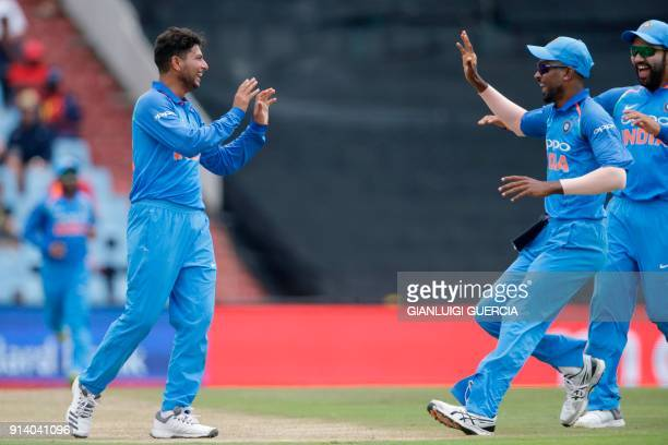 Indian bowler Kuldeep Yadav celebrates the dismissal South African batsman David Miller during the second One Day International cricket match between...
