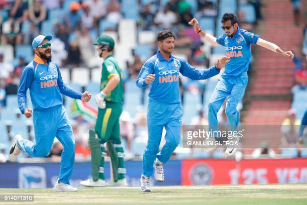 Indian bowler Kuldeep Yadav celebrates the dismissal South African batsman Kagiso Rabad during the second One Day International cricket match between...