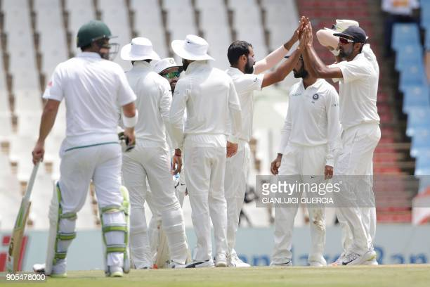 Indian bowler Mohammed Shami celebrates the dismissal of South Africa's AB de Villiers during the fourth day of the second Test cricket match between...
