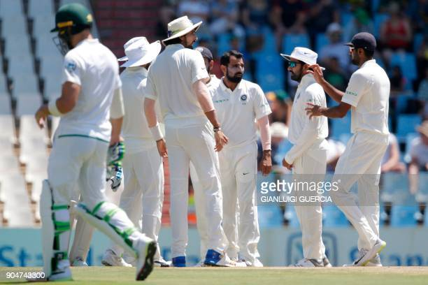 Indian bowler Mohammed Shami celebrates the dismissal of South African batsman Keshav Maharaj during the second day of the second Test cricket match...