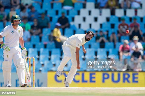 Indian bowler Mohammed Shami delivers a ball to South African batsman Aidan Markram during the first day of the second Test cricket match between...