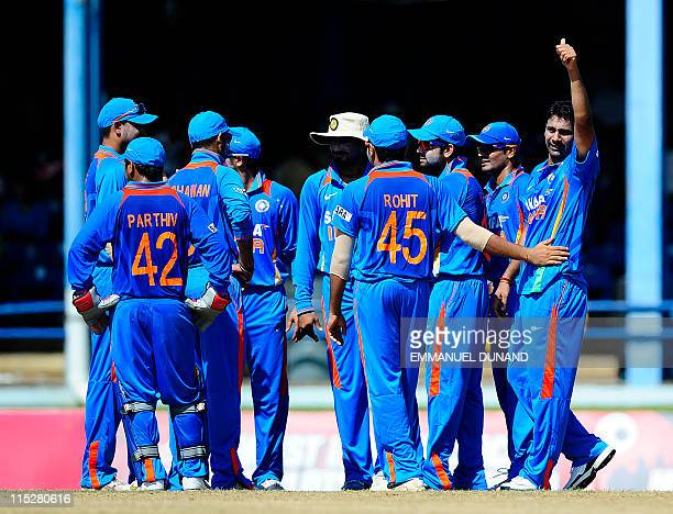Indian bowler Parveen Kumar celebrates with tammates after taking the wicket of West Indies batsman lendl Simmons during the first ODI bewteen West...