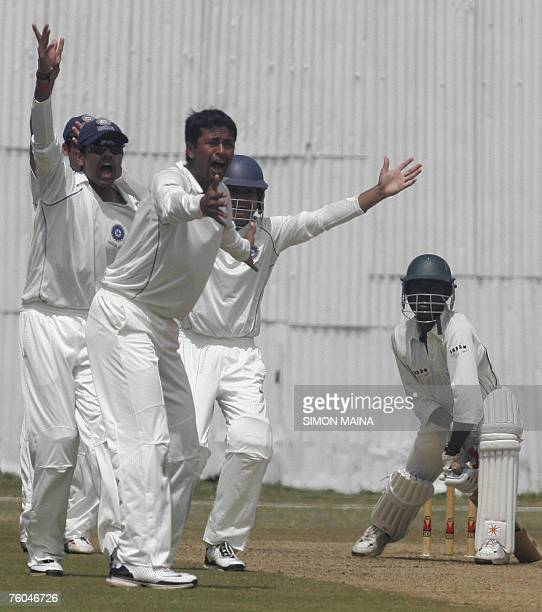 Indian bowler Pragyan Ojha and teammates appeal against Kenya's batsman Alex Obanda 10 August 2007 during their threeday match at Mombasa Sports Club...