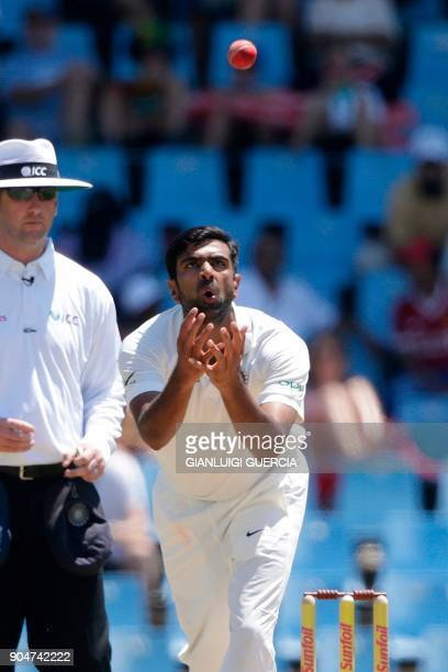 Indian bowler Ravichandran Ashwin eyes the ball during the second day of the second Test cricket match between South Africa and India at Supersport...